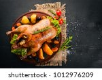 baked turkey with vegetables... | Shutterstock . vector #1012976209