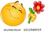 happy emoticon giving a flower | Shutterstock .eps vector #1012988929