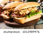 ciabatta sandwich with smoked... | Shutterstock . vector #1012989976