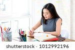 young asian female college...   Shutterstock . vector #1012992196