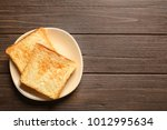 plate with toasted bread on...   Shutterstock . vector #1012995634