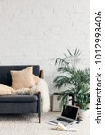 comfy couch in white living... | Shutterstock . vector #1012998406