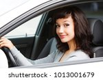 pretty woman driver smiling to... | Shutterstock . vector #1013001679
