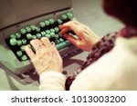 typist. woman sitting at the... | Shutterstock . vector #1013003200