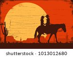 silhouette of cowboy couple... | Shutterstock .eps vector #1013012680