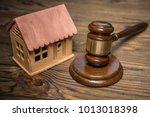 house  judge hammer on a wooden ... | Shutterstock . vector #1013018398