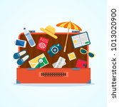 open baggage with travel icons... | Shutterstock .eps vector #1013020900