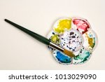 artists flower shaped style... | Shutterstock . vector #1013029090