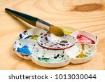 artists flower shaped style... | Shutterstock . vector #1013030044