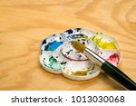 artists flower shaped style... | Shutterstock . vector #1013030068