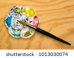 artists flower shaped style... | Shutterstock . vector #1013030074