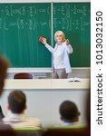 woman as math teacher in... | Shutterstock . vector #1013032150