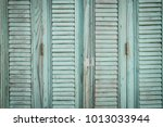 wooden painted shutters | Shutterstock . vector #1013033944
