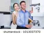 husband and wife are choosing... | Shutterstock . vector #1013037370