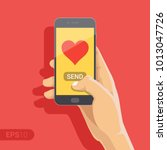 sending love message concept.... | Shutterstock .eps vector #1013047726