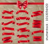 red ribbon and bow with... | Shutterstock .eps vector #1013056420