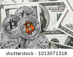 coins of the bitcoin against... | Shutterstock . vector #1013071318