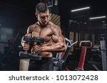handsome man with big muscles... | Shutterstock . vector #1013072428