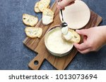 Small photo of french vacherin mont d'or, soft cheese with washed rind, scooping with a spoon