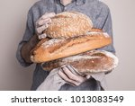 pile of rustic crusty loaves of ... | Shutterstock . vector #1013083549
