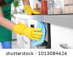 woman cleaning oven in kitchen  ... | Shutterstock . vector #1013084626