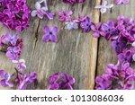 Purple Lilac Flowers On Rustic...