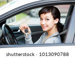 happy female driver showing car ...   Shutterstock . vector #1013090788