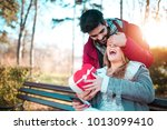young man with giftbox closing... | Shutterstock . vector #1013099410