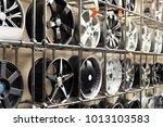 rack with car wheels in... | Shutterstock . vector #1013103583
