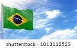flag of brazil on flagpole... | Shutterstock . vector #1013112523