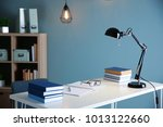 stacks of textbooks on table in ... | Shutterstock . vector #1013122660