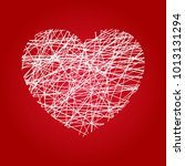 heart in grunge style on red... | Shutterstock . vector #1013131294