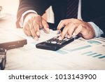 a businessman analyzing... | Shutterstock . vector #1013143900