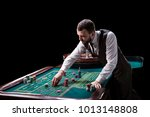 croupier behind gambling table...   Shutterstock . vector #1013148808