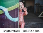 dirty plastic naked baby doll... | Shutterstock . vector #1013154406