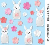 origami white paper rabbit with ... | Shutterstock .eps vector #1013157538
