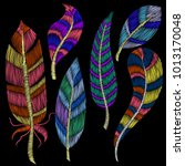 colorful feathers for... | Shutterstock .eps vector #1013170048