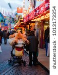 Small photo of Hamburg, Germany - April 06 2008: oversized teddy bear and heart of plush on a stroller at a fair