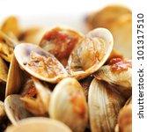 closeup of clams in marinara sauce - stock photo