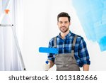 smiling man standing with paint ... | Shutterstock . vector #1013182666