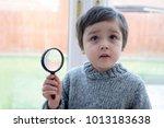 portrait kid boy holding... | Shutterstock . vector #1013183638