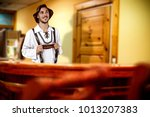 young bavarian man and his own...   Shutterstock . vector #1013207383