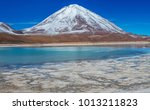 laguna verde at the foot of the ... | Shutterstock . vector #1013211823