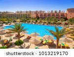 Small photo of HURGHADA, EGYPT - APR 13, 2013: Tropical resort Three Corners Sunny Beach in Hurghada. Three Corners is Belgian company with 11 hotels at Red Sea in Egypt and one in Budapest, Hungary.