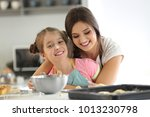 mother and daughter with cookie ... | Shutterstock . vector #1013230798