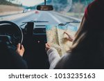 happy couple traveling by... | Shutterstock . vector #1013235163
