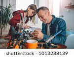 father and daughter sitting by...   Shutterstock . vector #1013238139