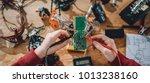 girl checking circuit board... | Shutterstock . vector #1013238160