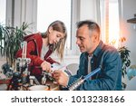 father and daughter sitting by... | Shutterstock . vector #1013238166