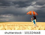 Small photo of Girl with umbrella at field